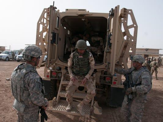 _media_2015_04_02_GGM_MilitaryTimes_635635918969558965-ARM-iraq-fight-2.JPG