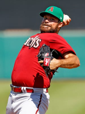 Arizona Diamondbacks starting pitcher Josh Collmenter (55) throws against the San Francisco Giants  in their spring training game Tuesday, March 17, 2015 at Salt River Fields at Talking Stick.