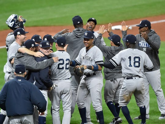 The Yankees celebrate after Game 5