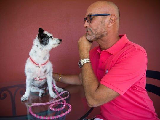 Kiki's owner Tim Kling sits next to Kiki outside of