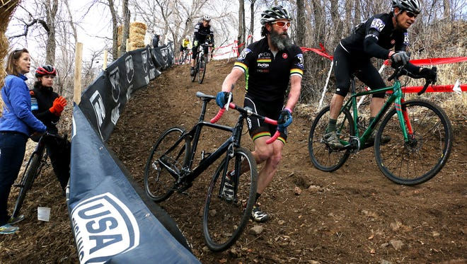 Racers navigate a steep and technical section of the course during the Cyclocross National Championships at Rancho San Rafael Regional Park in Reno on Jan. 10, 2018.