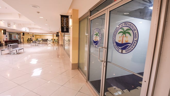Guam Department of Revenue and Taxation logos could be found posted on the doors of office retail space on the second floor of the Agana Shopping Center, on Thursday, Nov. 30, 2017. Preparations were being done at the location where the agency plans to open a satellite office on Dec. 1.