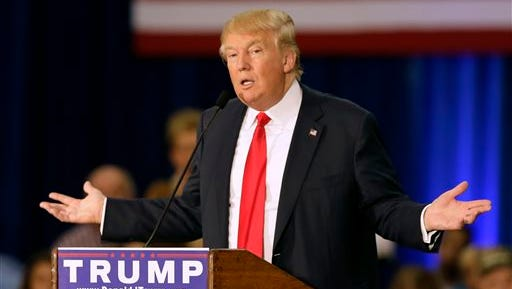 FILE - In this Aug. 25, 2015 file photo, Republican presidential candidate Donald Trump speak in Dubuque, Iowa. Not only is Trump an unconventional candidate, he's got a campaign operation that turns the conventional wisdom of electoral politics on its head. (AP Photo/Charlie Neibergall, File)