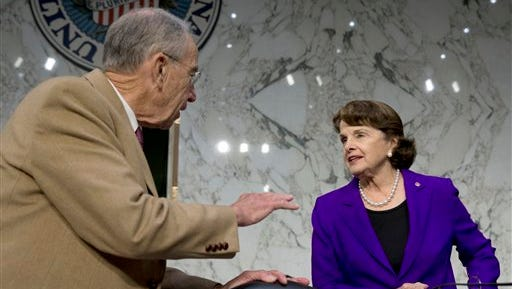 Senate Judiciary Committee Chairman Sen. Charles Grassley, R-Iowa, left, talks with member Sen. Dianne Feinstein, D-Calif. on Capitol Hill in Washington, Monday, Oct. 19, 2015, prior to the start of the committee's hearing on the Sentencing Reform and Corrections Act of 2015.  (AP Photo/Carolyn Kaster)