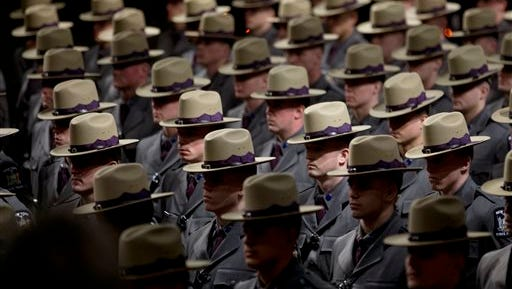 Some of the nearly 230 graduating troopers stand during the New York State Police 202nd session graduation ceremony at the Empire State Plaza Convention Center on Tuesday, Feb. 10, 2015, in Albany, N.Y.
