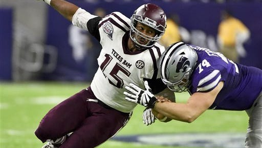 Texas A&M's Myles Garrett (15) tries to get around Kansas State offensive lineman Scott Frantz during a game during the 2016 season.