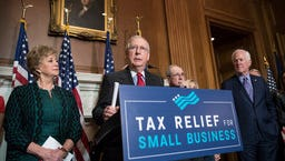 Senate Majority Leader Mitch McConnell, R-Ky., center, and other Republicans tout the GOP tax plan Tuesday in Washington.