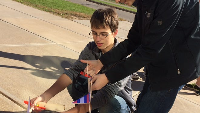 In 2014, Wausau Engineering and Global Leadership Academy students Andrew Borski, left, and James Shutts, try out rubber-band-powered, balsa-wood planes they made as part of a history of flight lesson.