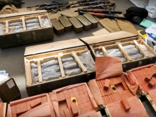 In this image, provided by the Ukrainian Intelligence Agency SBU on Monday, June 6, 2016, confiscated ammunition and explosives are on a display at the Yahodyn border crossing on the Ukrainian-Polish border, Ukraine. Ukraine's intelligence agency SBU said on Monday it has thwarted a plot to attack soccer's European Championships in France by arresting a Frenchman who wanted to cross from Ukraine into the European Union armed to the teeth. (Ukraine's Intelligence Agency SBU Press Service photo via AP)