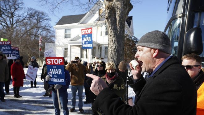 Jesse Case with the Teamsters Local 238 gets the crowd pumped up as they protest outside Iowa State Sen. Majority Leader Bill Dix's home Saturday in Shell Rock.