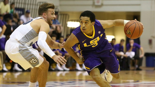 LSU guard Tremont Waters (3) tries to get around Marquette guard Andrew Rowsey (30) during the first half of Wednesday's game.