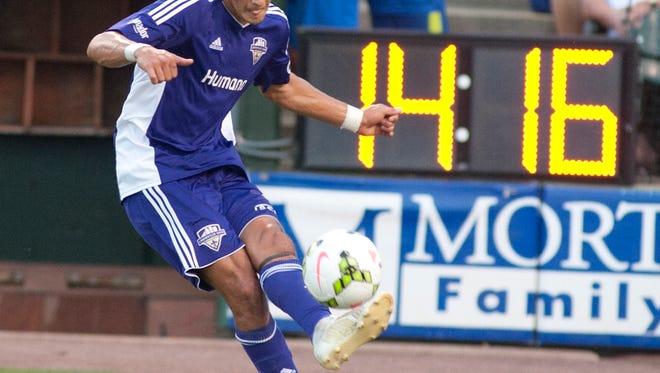 Louisville City FC defender Enrique Montano hits a corner kick.29 Aug 2015
