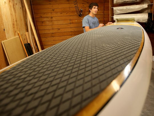 Andrew VanderWeyden talks about the process of making and repairing stand-up paddleboards.