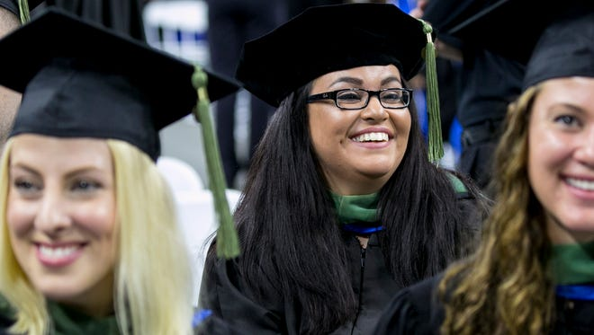 Courtney Faunce overcame a traumatic brain injury to get her masters degree on Saturday from FGCU.