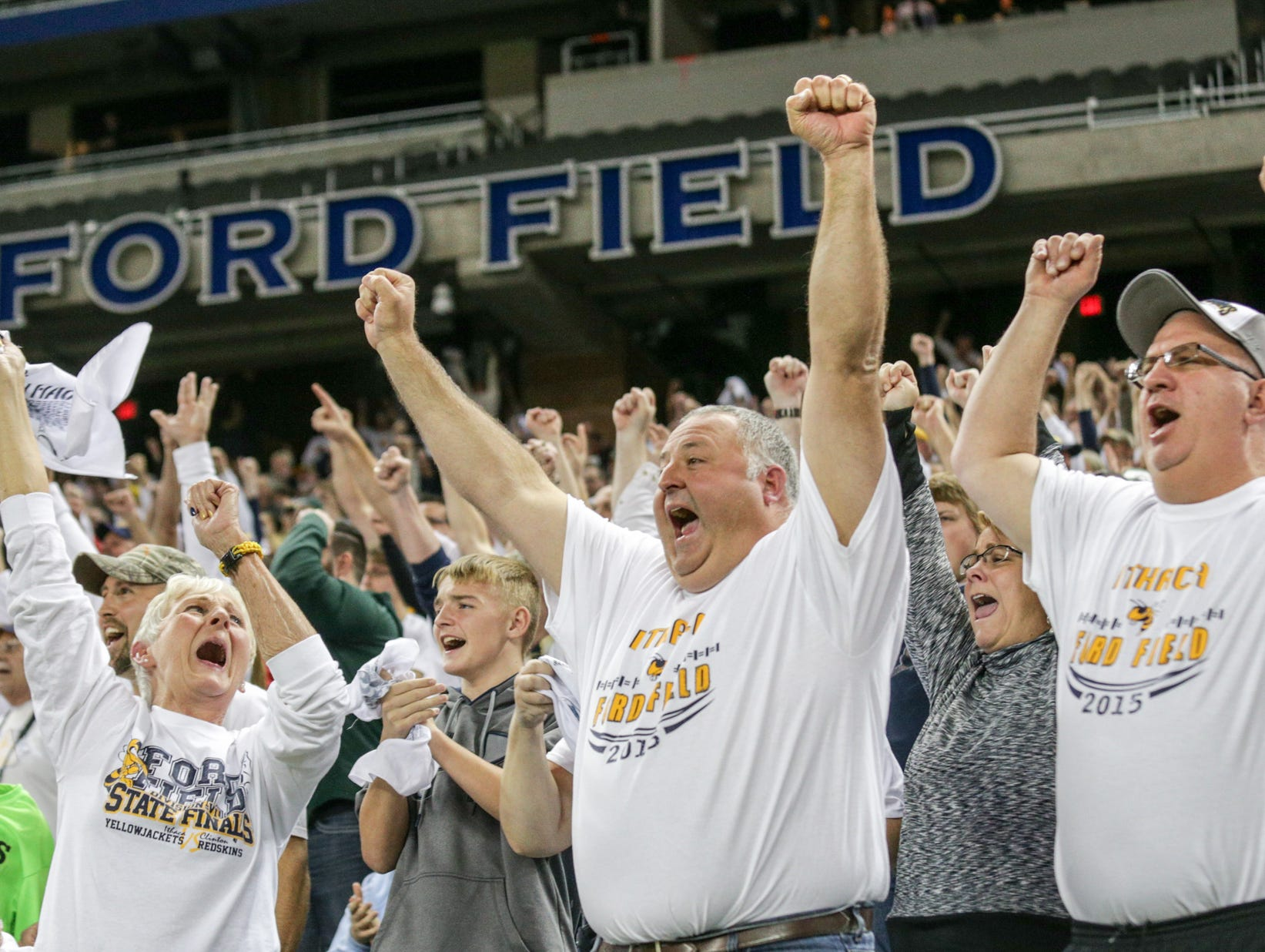 Ithaca fans cheer on their team in the final minutes of Ithaca's 27-20 win over Clinton in the Division 6 state final Friday at Ford Field.