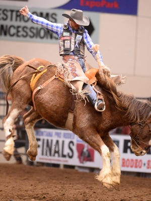 Tyrell Smith.rides high at the Montana Pro Rodeo Circuit Finals in January of 2017.