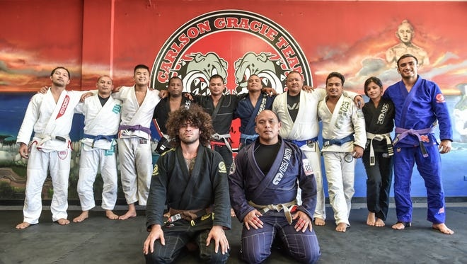 Mike Carbullido, front left, winner of double gold medals at the Jiu-Jitsu federation of Japan All Japan 2015 Tournament, trains with at the Carlson Gracie Academy in Anigua on Dec. 31.