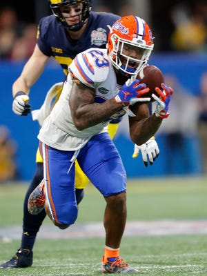 FILE - In this Dec. 29, 2018, file photo, Florida defensive back Chauncey Gardner-Johnson (23) makes the catch for an interception against Michigan during the second half of the Peach Bowl NCAA college football game, in Atlanta. Gardner-Johnson is a possible pick in the 2019 NFL Draft. (AP Photo/John Bazemore, File)