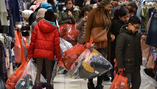 Shoppers crowd the shop floot at a Next department store during the Boxing Day sales at Highcross Shopping Center in Leicester England  on Dec. 26, 2016.