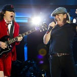 AC/DC's Angus Young, left, and Brian Johnson perform during their Rock or Bust World Tour at Gillette Stadium in Foxborough, Mass. Saturday, Aug. 22, 2015.