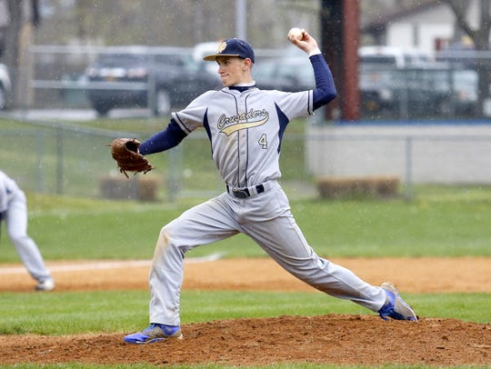 Notre Dame's Kyle Minchin delivers a pitch to an Edison