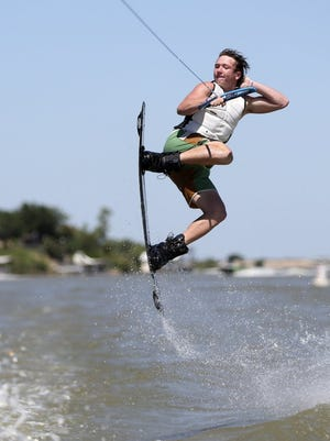 Ty Harmon, of San Angelo, completes a trick at the 2015 Wake the Desert contest at Lake Nasworthy.
