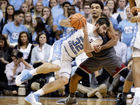 North Carolina's Luke Maye (32) drives to the basket while Boston College's Jerome Robinson defends during the second half of an NCAA college basketball game in Chapel Hill, N.C., Tuesday, Jan. 9, 2018. North Carolina won 96-66. (AP Photo/Gerry Broome)
