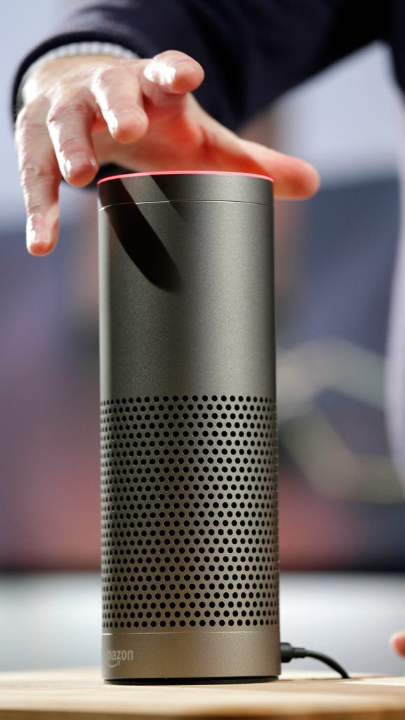 The Amazon Echo Plus is displayed during a program announcement on Sept. 27, 2017, in Seattle.