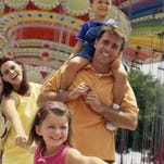 Parents with their son and daughter at an amusement park