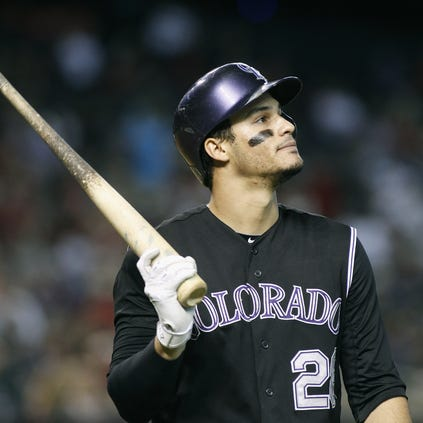 PHOENIX, AZ - AUGUST 31:  Nolan Arenado #28 of the Colorado Rockies reacts after striking out against the Arizona Diamondbacks during the fourth inning of a MLB game at Chase Field on August 31, 2014 in Phoenix, Arizona.  (Photo by Ralph Freso/Getty Images)