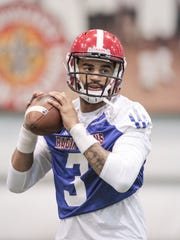 Ragin' Cajun quarterback Jordan Davis, show here during spring drills earlier this year, has won in 2017 the No. 1 job that evaded him last year.