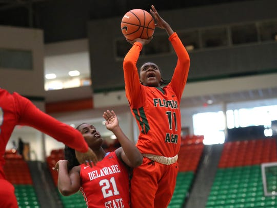 FAMU's Florence Ouattara shoots over Delaware State's A'Nikeyawna Barber at the Al Lawson Center on Monday, Jan. 15, 2018.