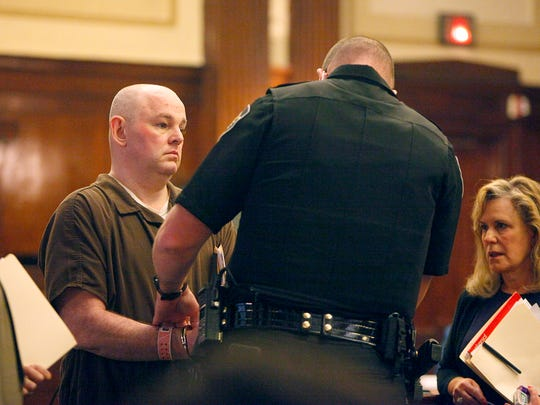 Robert Jason Owens, 37, is escorted out of the courtroom in handcuffs after Judge Mark Powell approved the plea deal to send Owens to prison for at least 59.5 years without parole April 27 in Buncombe County Superior Court.