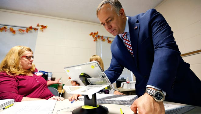 Greene County Clerk Shane Schoeller attempts to fix an iPad used to check in voters at the polling place located inside Glenstone Baptist Church in Springfield, Mo. on Nov. 8, 2016.
