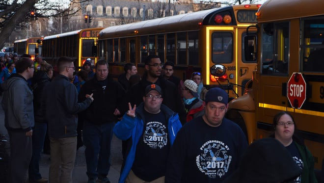 Athletes step off of buses and head for the Poughkeepsie Grand Hotel hours before the opening ceremony of the Special Olympics New York Winter Games, held at the Mid-Hudson Civic Center in the City of Poughkeepsie.