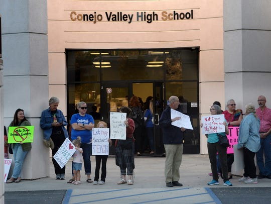 Demonstrators stand outside the Conejo Valley Unified