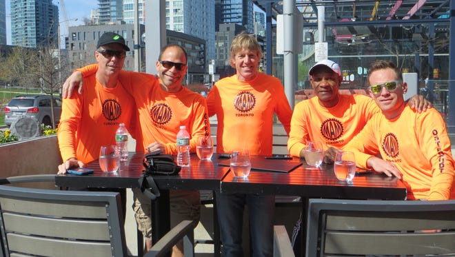 "The ""Middle Aged Machines"" pose together during their trip to run in Toronto."