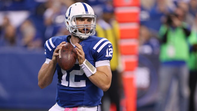 Indianapolis Colts quarterback Andrew Luck (12) throws a pass against the Baltimore Ravens at Lucas Oil Stadium.