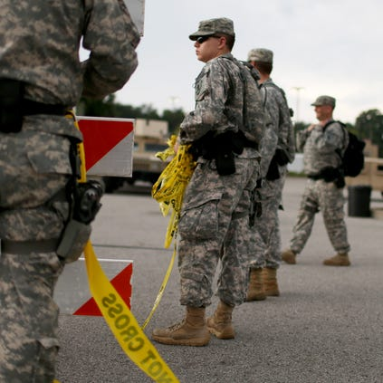 FERGUSON, MO - AUGUST 19:  Missouri National Guard troops are deployed to provide protection for a police command center on August 19, 2014 in Ferguson, Missouri.