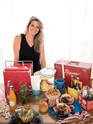 """Megan Low Nobile, the owner of  Fresh & Fancy Farms in New Milford, poses with her healthy tailgating """"game day"""" recipes"""