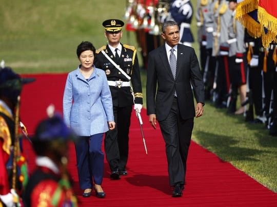 President Barack Obama and South Korean President Park Geun-hye inspect an honor guard during a welcoming ceremony at the presidential Blue House in Seoul on April 25, 2014.
