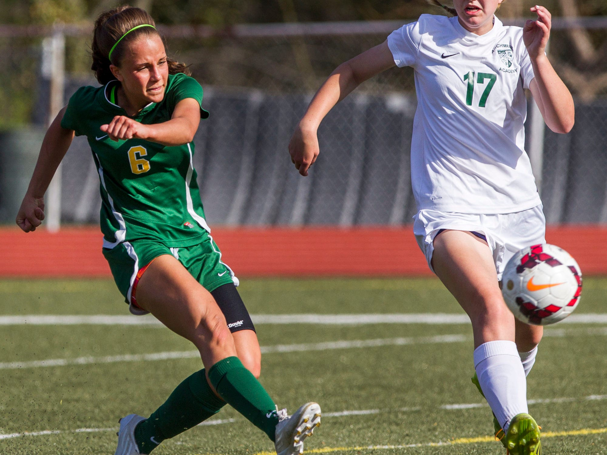 St. Mark's Madison Burnham shoots and scores past Archmere's Lauren Murray Wednesday afternoon. Archmere defeated St. Mark's by a score of 2-1.