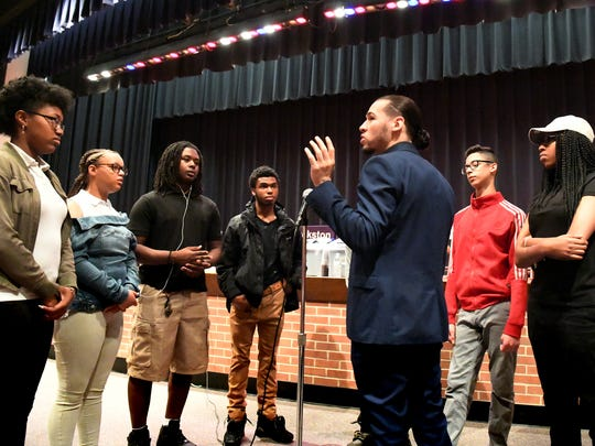 Helen Thackston Charter School music teacher Jazze Palmer talks with members of the gospel choir during a rehearsal for commencement at Hannah Penn K-8 Thursday, May 31, 2018. The graduation takes place there Friday at 6 p.m. This could potentially be the last class of seniors to graduate at Thackston as the school heads into a trial June 15 with York City School District that could result in them having to close by June 30. Bill Kalina photo