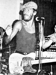 Bruce Springsteen performs with the E Street Band at the Stone Balloon Tavern on Main Street in Newark, Del. on August 13, 1974.