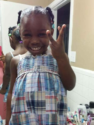 Paris Hill, 3, was shot in the head Friday. Her parents said she was in her father's arms when an intruder entered their kitchen and shot.