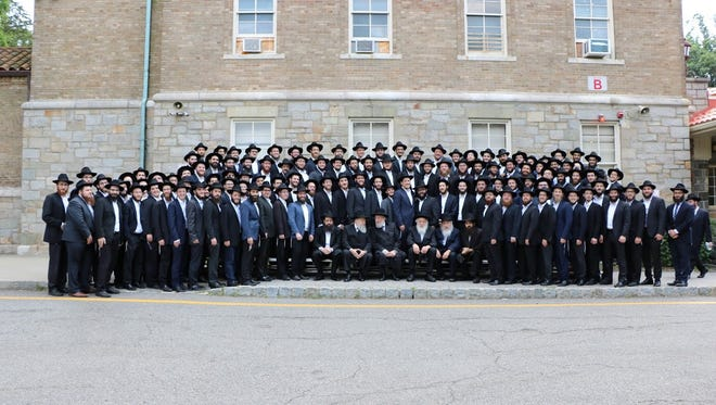 Graduates with their professors and Israel Lau, at the Rabbinical College of America graduation in Morris Township on June 26, 2016