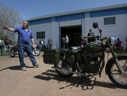Steve Kasten points at a bidder as a 2003 Royal Enfield