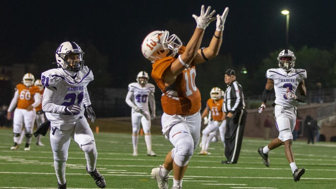 Westwood's Robbie Jeng hauls in a touchdown pass against Cedar Ridge last season. Jeng returns as part of a veteran receiving corps for the Warriors.