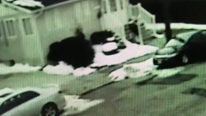 A screen capture of a surveillance video documenting a trap set for package thieves in Clifton.