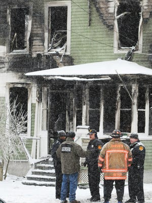 In this file photo, Town of Poughkeepsie and the Fairview Fire Department officials work at the scene of a fatal fire at 112 Fairview Avenue in the Town of Poughkeepsie on January 21, 2012.